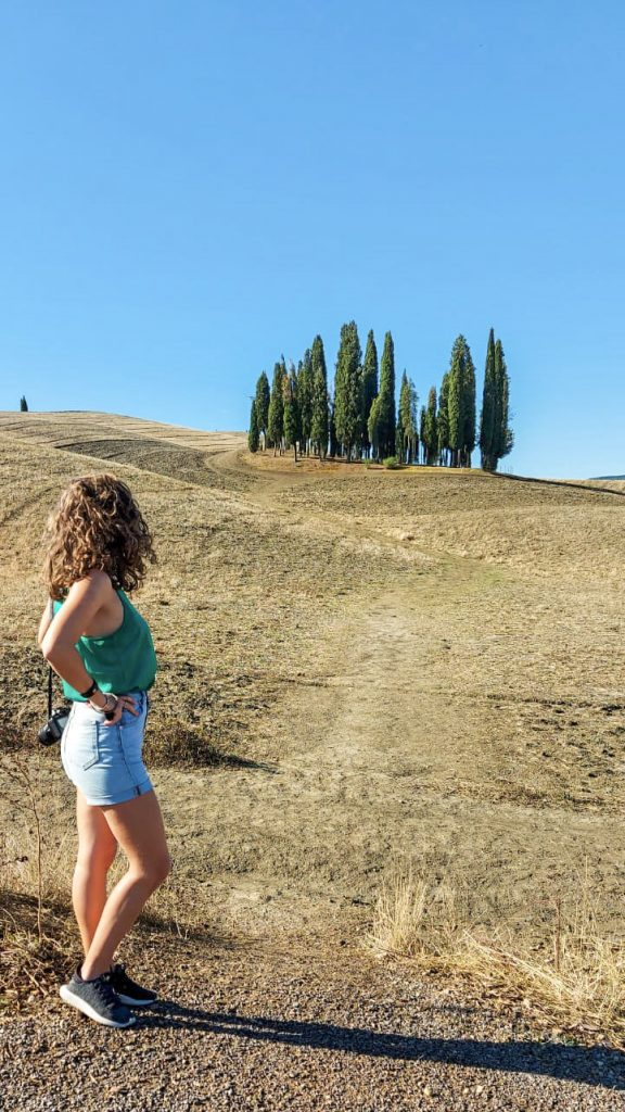 Me looking at Cipressi of San Quirico d'Orcia